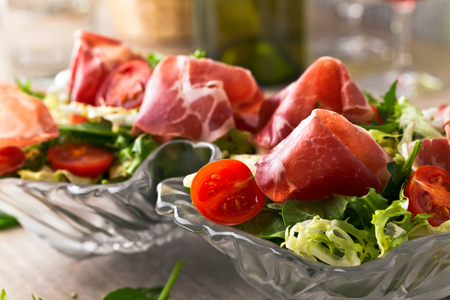 jamon: green salad with jamon on a kitchen table