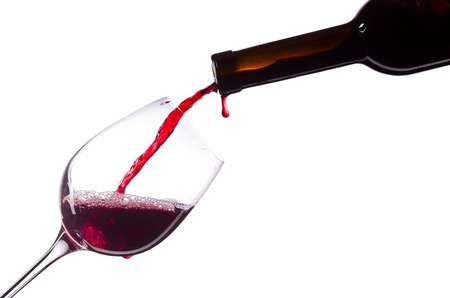 glass of red wine: Red wine in wineglass on white background