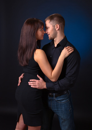 loving couples: young couple in love on black background Stock Photo