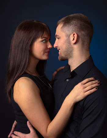 romantic man: young couple in love on black background Stock Photo