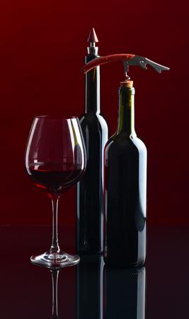 closed corks: red wine bottles and corkscrew , studio shot