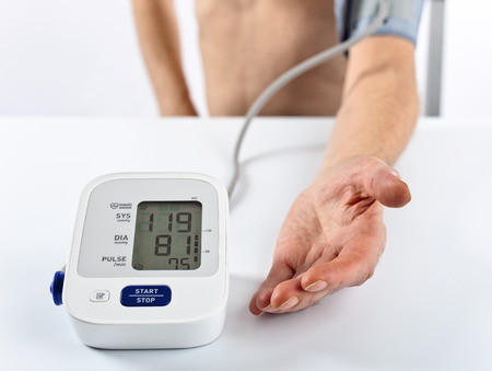 hypotension: patient with a tonometer , focus on foreground