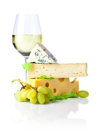 bri: cheeses with grapes and wine on white background