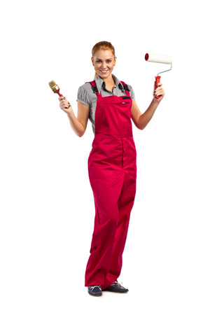 jumpsuit: Young happy woman in red jumpsuit with painting tools, isolated on white