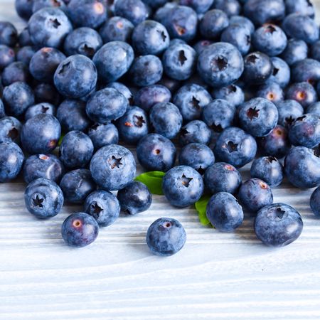 woden: ripe blueberries on a old woden table