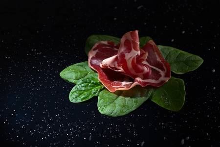 jamon: jamon with spinach  on a dark background Stock Photo