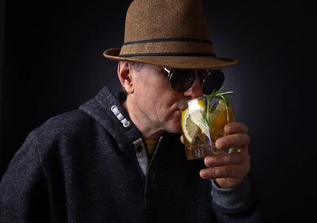 alcoholic drink: Portrait of a man with glass of alcoholic drink
