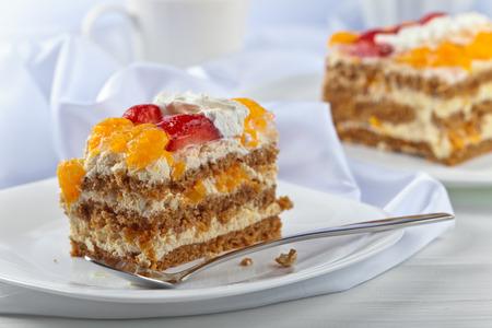 honey cake: Homemade honey cake with strawberries and orange