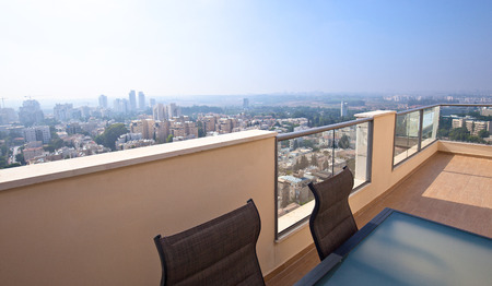 high end: High end balcony in downtown of modern city