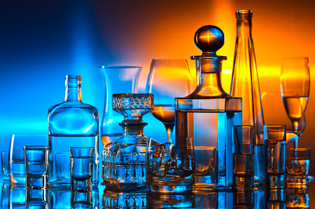 alcoholic drinks: alcoholic drinks in bar on glass table