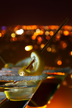 sweet vermouth: martini with lemon , macro shot, focus on a foreground