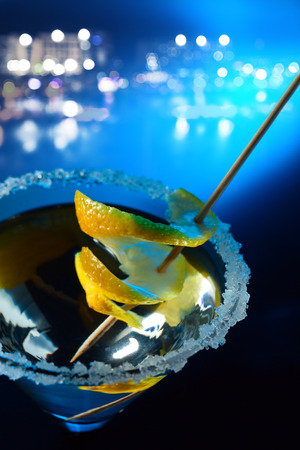 sweet vermouth: cocktail with lemon on a background of night city Stock Photo