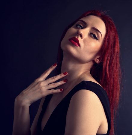 redheaded: portrait of a beautiful redheaded woman in a black dress