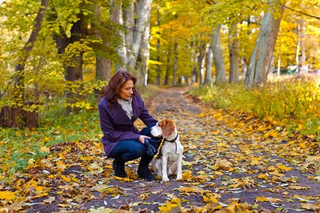 woman with dog walking in the park