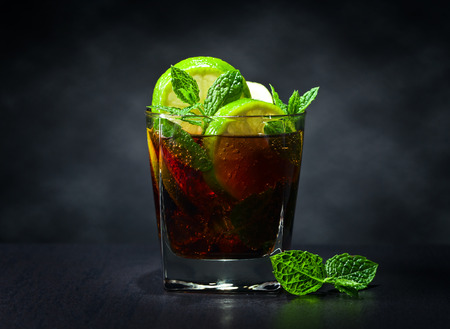 cocktail Cuba libre with lime , ice  and peppermint leaves