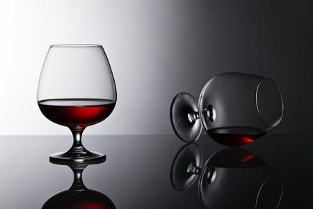 reflective: Two snifters of brandy on the reflective background Stock Photo