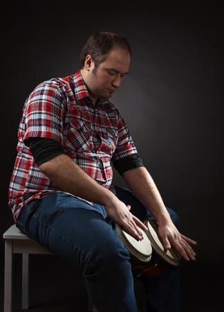 bongo: portrait of musician with bongo , studio shot