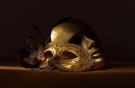 foreground focus: Two golden Venetian masks , focus on foreground Stock Photo