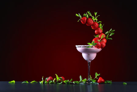 strawberry cocktail with berries and peppermint leaves
