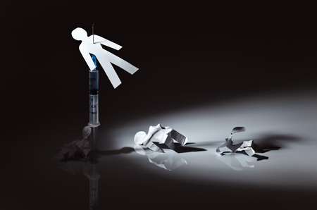 The conceptual image on a theme of narcotic dependence, white reflective background. Stock Photo