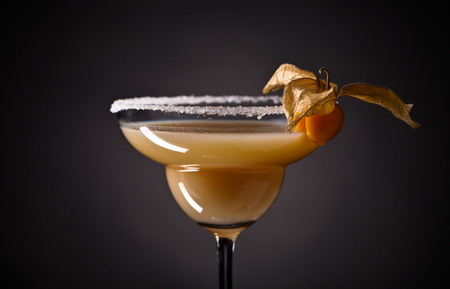 sweet vermouth: Cocktail with physalis on a dark background Stock Photo