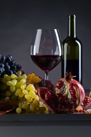 Ripe juicy grape and glass of wine on a kitchen table Stock Photo