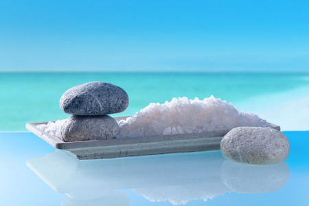 Sea salt with stones on a background of seascape
