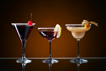 sweet vermouth: Different cocktails with fruits on a dark background Stock Photo