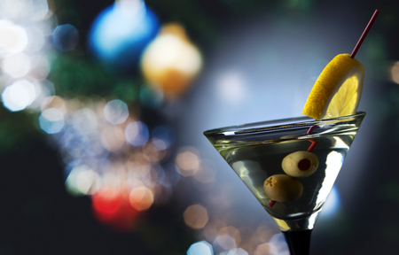 Glass of martini with lemon and green olives Stock Photo