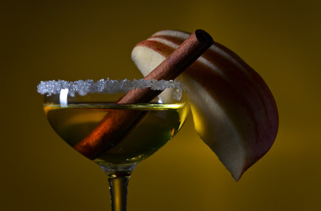 sweet liquor with apple and cinnamon stick Stock Photo