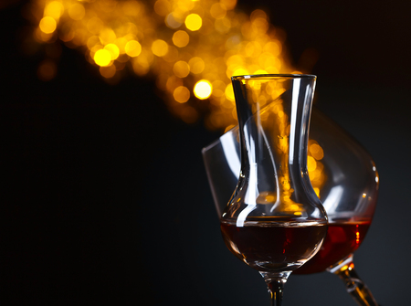 alcoholic drink: Glasses of alcoholic drink on a dark background Stock Photo
