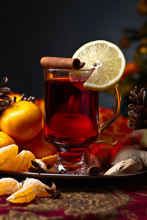 The mulled wine with spices , lemon and tangerines