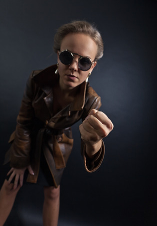 leather coat: woman in leather coat, conceptual image on the subject of domestic violence, focus on a foreground