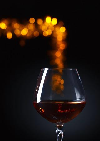 snifter: Snifter of brandy on a dark background Stock Photo