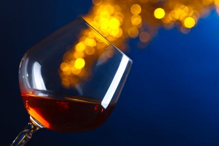 Snifter of brandy on a blue background