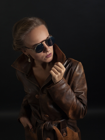 leather coat: beautiful woman in brown leather coat and sunglasses