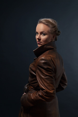 leather coat: Portrait of young beautiful woman in leather coat