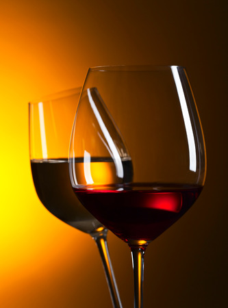 translucent red: Closeup of glasses with red and white wine Stock Photo