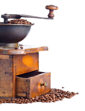 old coffee grinder and roasted coffee beans isolated on white background