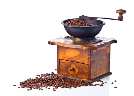 molinillo:  old coffee grinder and roasted coffee beans isolated on white background