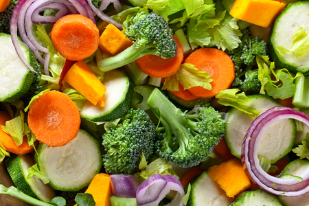 Close-up of sliced fresh raw vegetables, top view