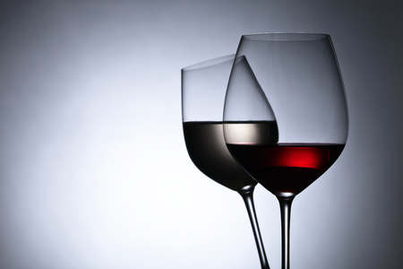 translucent red: Closeup of glasses with red and white wine,free space for your text Stock Photo