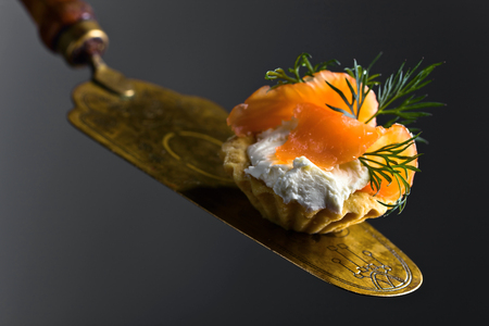 Canapes with smoked salmon or trout , cream cheese and dill . Tasty snack. Seafood.