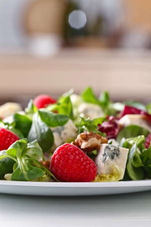 Green salad with blue cheese , raspberry and walnuts Stock Photo