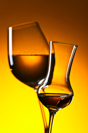 Closeup of glasses with white wine , focus on a foreground Stock Photo