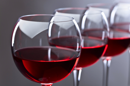 Glasses of red wine on a dark background