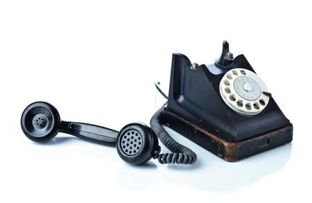 昔の黒電話は、白い背景で隔離。 写真素材