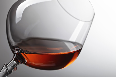 Snifter of brandy with copy space for text . Stock Photo