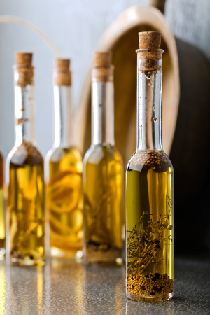 Olive oil with different spices and herbs. Stok Fotoğraf