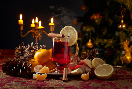 Mulled wine with spices , lemon and tangerines .Christmas concept .